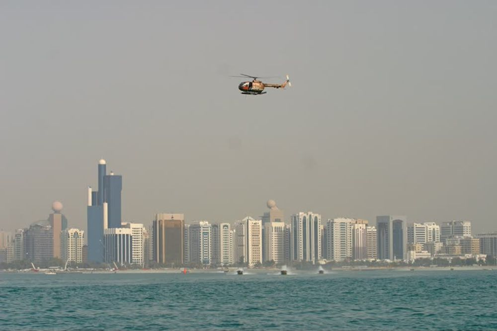 title: Small Helicopter Flying over the Gulf Sea