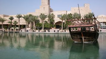 title: The Breathtaking Scenery of the Abra Boat on the Lagoon of Madinat Jumeirah in Dubai UAE