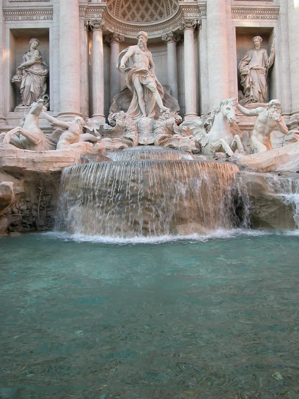 title: Flowing Waters of the Trevi Fountain in Roma