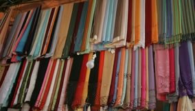 title: Colorful Scarves on Display at the Souk for Sale