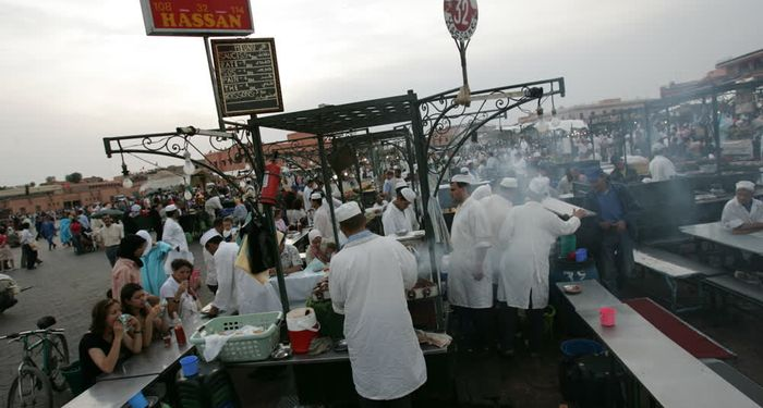 title: Cooking in the Evening at Food Stall Hassan 32 on the Jemaa el Fna Public Square