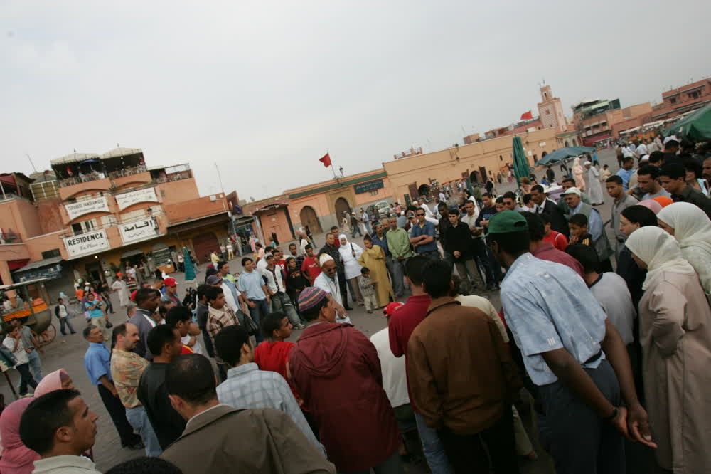 title: Crowds Gathered Around Street Dancer for Entertainment in Jemaa elFnaa