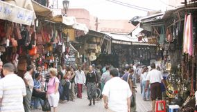 title: Crowds Shopping at the Souk