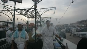 title: Local Moroccan Chefs at Food Stall Hassan 31 on Djemaa el Fnaa