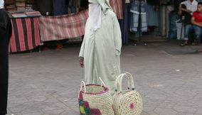 Moroccan Lady with her Straw Handmade Baskets in the Souk