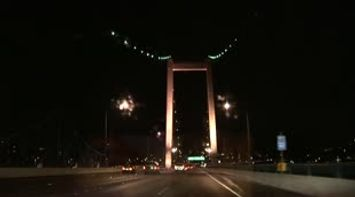 title: San Francisco driving across the golden gate bridge at night