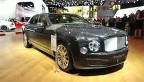 title: Black Shiny Bentley on Display at the Paris 2012 Car Show