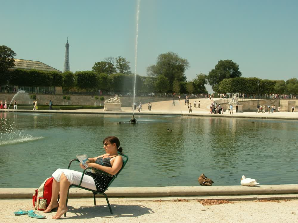 title: Local French Citizens Lounging in Jardin des Tuileries