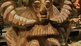 title: Ancient Wooden Head Sculpture with Goat Horns