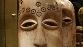 Droopy Eyes and Long Face of a Terracotta Bust Statue