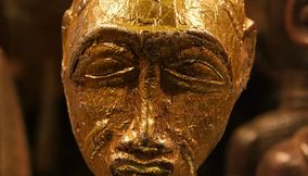 title: Golden Bust Statue of an Ancient Citizen