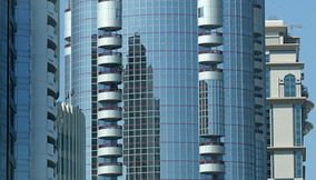 title: Modernized Glass Buildings Reflecting Each Other in Abu Dhabi