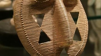 title: Old Mask with Cut Out Triangles at the Hotel