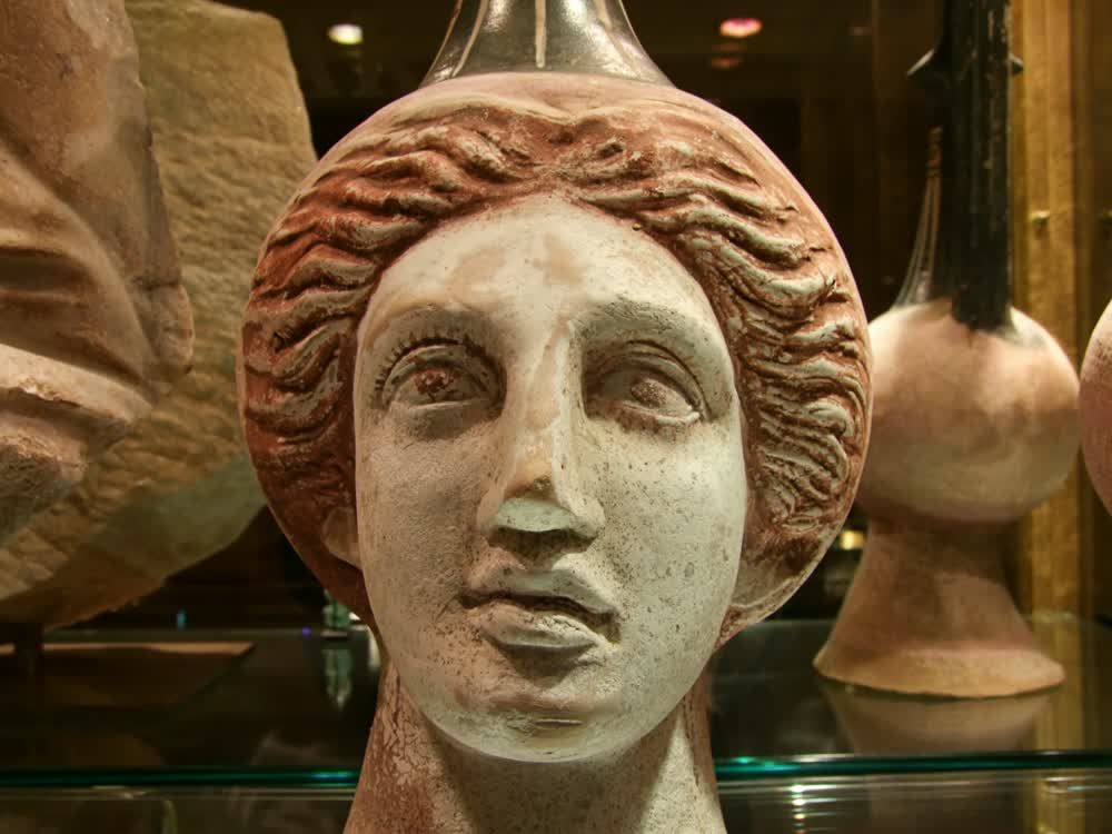 title: Roman or Greek Head Sculpture from Ancient Civilization