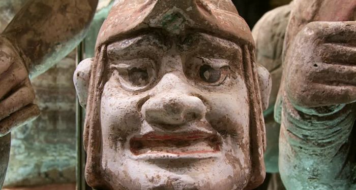title: Smiling Terracotta Statue of a Bust in the Hotel