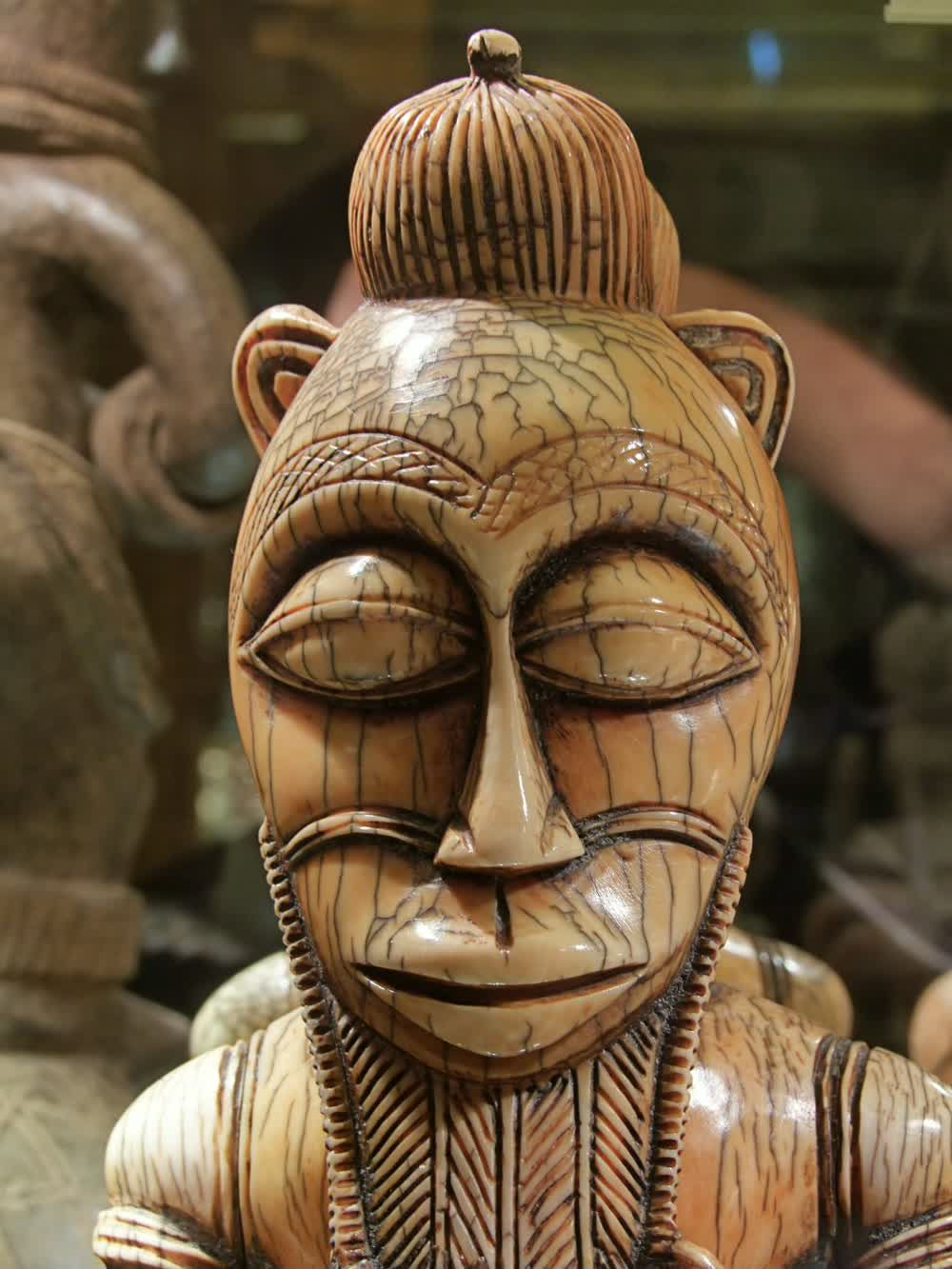 title: Tribal Head Bust Sculpture with Close Eyes