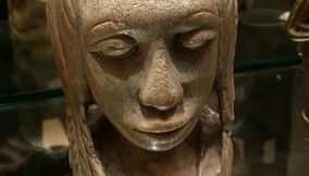 title: Wooden Lady Bust Statue at the Art Exhibit