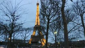 title: La Tour Eiffel Illuminated and Snow