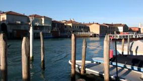 title: Video of Boats Driving on the Sea Shore of Murano Island Venice
