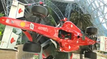 title: Ferrari formula one car rotating on a Fixed Stable Axis as Display