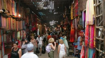 title: Busy Crowded Souks of Marrakesh in Maroc
