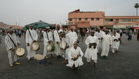 Local Moroccans Dancing in Tradtional Clothes in Jemaa elFnaa Square