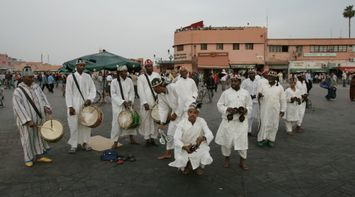 title: Local Moroccans Dancing in Tradtional Clothes in Jemaa elFnaa Square