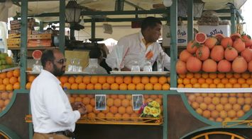 title: Orange and Grapefruit Juice for Sale at a Kiosk in Jemaa elFnaa
