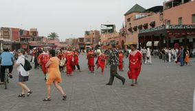 Traditional Red Moroccan Clothing Dance in Jemaa elFnaa Marketsquare