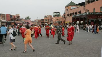 title: Traditional Red Moroccan Clothing Dance in Jemaa elFnaa Marketsquare