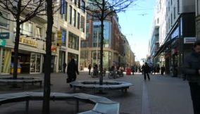 title: Busy and Noisy Street in Downtown Hamburg during the Day
