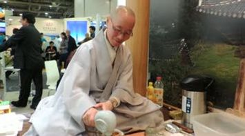 Korean Monk at South Korea Stand at ITB Berlin 2013 Germany