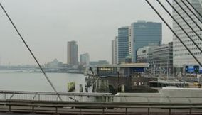 watch the Erasmusbrug Bridge in the centre of Rotterdam from The Willemsbrug bridge