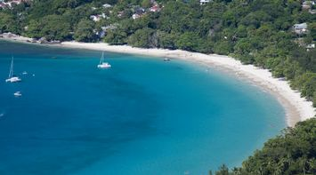 Beau Vallon a sweeping bay of white sand and clear waters Seychelles
