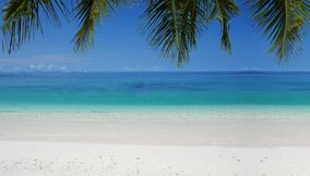 Clear blue sea white sandy beaches Seychelles