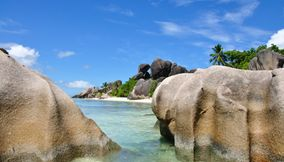 title: Granite boulders with unusual curves worn by weathering Seychelles