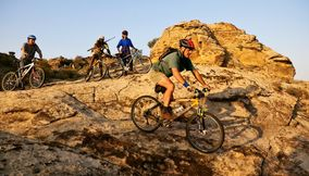 title: On bikes on a rugged terrain in Northern Tuli Game Reserve Botswana