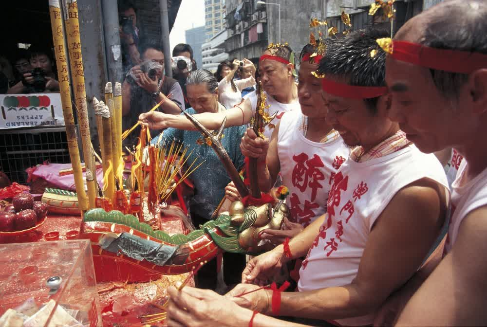 title: Burning incense for the gods Macau