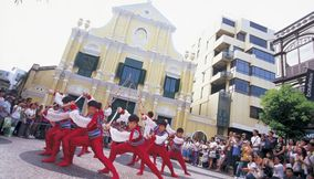 title: Dancers and tourists Macau