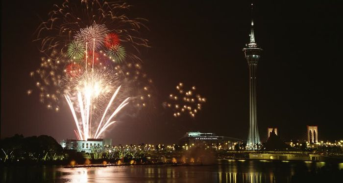 title: Holidays and fireworks next to china tower Macau