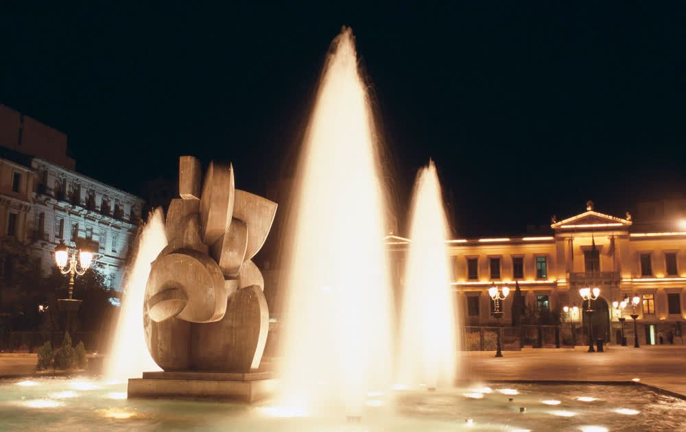title: Kotzia Square lit fountain Athens Attica Greece