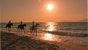 title: On horses at sunset Kos Greece