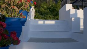 title: Stairs decorated with flowers Kos Greece