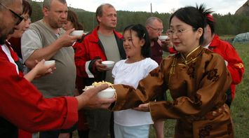 title: Tourists Enjoying food in Mongolia