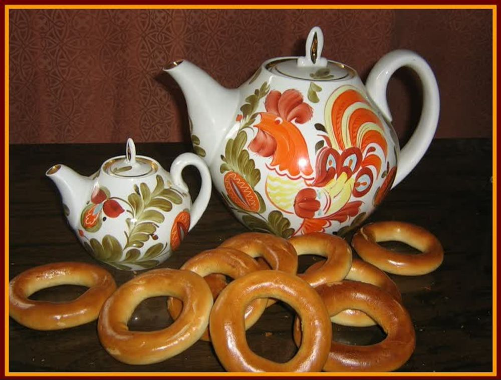 title: Big Tea Pot and Miniature Tea Pot made of Porcelain with Unique Creative Orange Designs and Traditional Russian Bagels