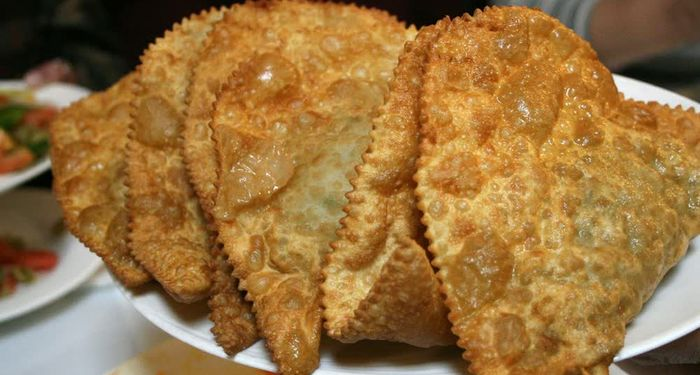 title: Chebureki Pies at the Buffet in Local Russian Restaurant