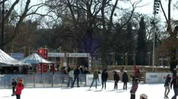 title: Children Laughing and Playing in the Ice Rink on Ringstrasse in Vienna Austria