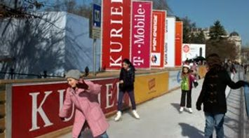 title: Children and Beginners Entering the Ice Skating Rink in Vienna Austria