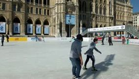 title: Video of the Public on Ice Rink in Front of Rathaus New City Hall in Vienna Austria