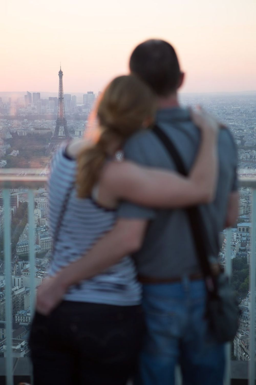 title: Couple Enjoying the Sunset from Tour Montparnasse 56 Terrace